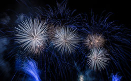 Fireworks. Celebrating the New Year with white, blue and orange fireworks Stock Image