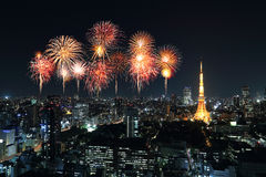 Fireworks celebrating over Tokyo cityscape at night Royalty Free Stock Images