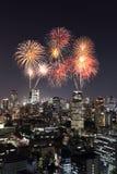 Fireworks celebrating over Tokyo cityscape at night, Japan Stock Image