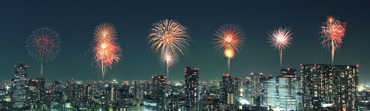 Fireworks celebrating over Tokyo cityscape at night, Japan Royalty Free Stock Photos