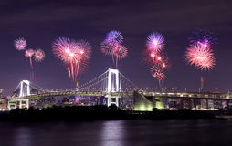 Fireworks celebrating over Tokyo Rainbow Bridge at Night, Japan Stock Image