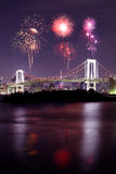 Fireworks celebrating over Tokyo Rainbow Bridge at Night, Japan Royalty Free Stock Image
