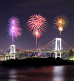 Fireworks celebrating over Tokyo Rainbow Bridge at Night Stock Images
