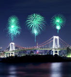 Fireworks celebrating over Tokyo Rainbow Bridge at Night Stock Photo
