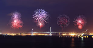 Fireworks celebrating over Yokohama Bay Bridge at night. Japan Stock Photography