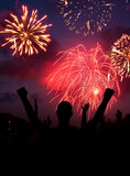 Fireworks Celebration. Fourth of July Fireworks celebration concept with cheering crowd Royalty Free Stock Photography