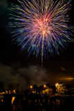 Fireworks celebration. With crowd in foreground Royalty Free Stock Photo