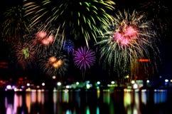Fireworks celebration and the city night light background. Stock Photos