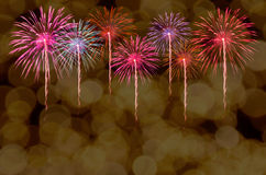 Fireworks celebration and the city night light background. Stock Images