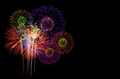 Fireworks celebration and the city night light background. Royalty Free Stock Images
