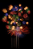 Fireworks celebration and the city night light background. stock photos