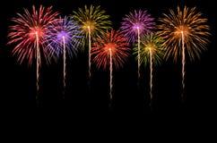 Fireworks celebration on dark background. Royalty Free Stock Photos