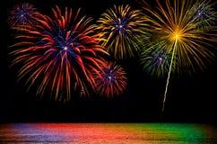 Fireworks celebration on dark background. Stock Photos