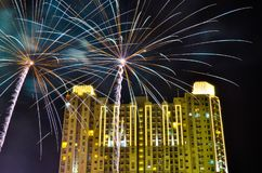 Fireworks celebration in downtown city center with tall apartment and office buildings stock image