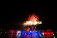 Fireworks Celebration Event.green.red.Thailand flag colors. Fireworks light water The Nong Prajak park udon countries Thailand Royalty Free Stock Photo