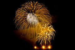 Fireworks celebration at night. Beautiful golden yellow and orange firework display celebration in the dark Stock Image