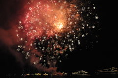 Fireworks at celebration in the night sky. Colorful fireworks night. Holiday festival at the coast. Summer national celebration with the colourful sparks in the Royalty Free Stock Photos