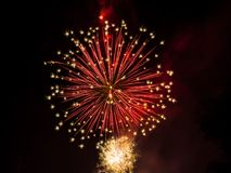 Fireworks. Celebration fireworks over night sky copy space. Celebration colorful fireworks. Beautiful fireworks. Holidays salute. Independence Day. New Year. Red Royalty Free Stock Image