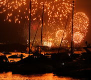 Golden display of fireworks in harbor Stock Photos