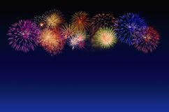 Fireworks celebration and the twilight sky background. Royalty Free Stock Image