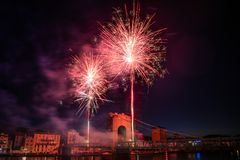 Fireworks during celebrations of French national holiday. Fireworks over the bridge during celebrations of French national holiday, July 14, in Vienne France royalty free stock photography