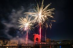 Fireworks during celebrations of French national holiday. Fireworks over the bridge during celebrations of French national holiday, July 14, in Vienne France royalty free stock image