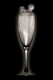 Fireworks in a champagne glass. An elegant, back-lit champagne glass with fireworks coming from inside Royalty Free Stock Image
