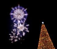 Fireworks Christmas eve tree Santa. Flower-like fireworks and huge Christmas tree decoration on Christmas Eve Stock Photos