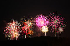 Fireworks in the city. Independence day and New year holidays. Stock Photos