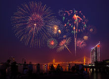 Fireworks in the city. Multiple fireworks exploding high in the sky at the bridge in city center royalty free stock image