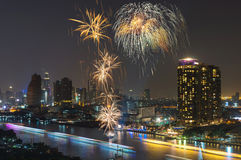 Fireworks with cityscape river view at night scene Stock Photos