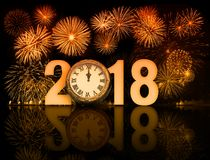 2018 fireworks with clock exactly at midnight 3d illustration. 2018 happy new year fireworks with exactly twelve o`clock Stock Photos