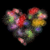 Fireworks colorful heart shape. On black background Stock Photos