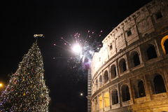 Fireworks at colosseum with a Christmas tree Royalty Free Stock Image