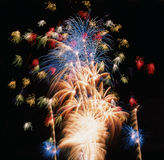 Fireworks colour. Timed exposure of a fireworks display showing multiple patterns of colourful fireworks Stock Photos