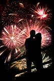 Fireworks Couple. A silhouette of a kissing couple in front of a huge fireworks display Stock Image