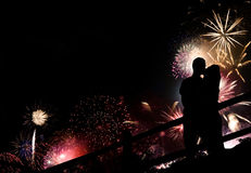 Fireworks Couple Silhouette. A silhouette of a kissing couple in front of a huge fireworks display Royalty Free Stock Photos