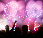 Fireworks and crowd celebrating the New year Stock Photography