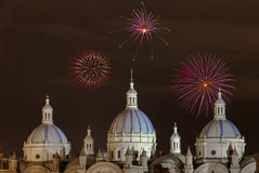 Fireworks in Cuenca, Ecuador. Fireworks over the domes of the New Cathedral in Cuenca, Ecuador. These are the famous view that are usually found on all travel Stock Photography