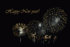 Fireworks on a dark background and a text `Happy New year`. Royalty Free Stock Photography