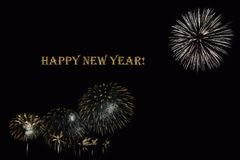 Fireworks on a dark background and a text `Happy New year`. Stock Photo