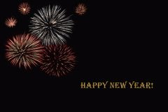 Fireworks on a dark background and a text `Happy New year`. Balanced image for wallpaper, perfect for using as a congratulation card Stock Photos