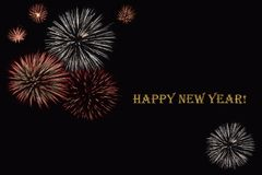 Fireworks on a dark background and a text `Happy New year`. Royalty Free Stock Photo