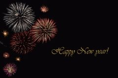 Fireworks on a dark background and a text `Happy New year`. Stock Photography