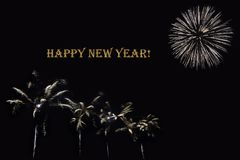 Fireworks on a dark background and a text `Happy New year`. Balanced image for wallpaper, perfect for using as a congratulation card Stock Images