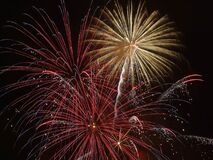 Fireworks in dark skies Royalty Free Stock Image
