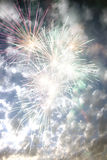 Fireworks in the Day. Fireworks exploding on the backdrop of a cloudy sky, during day time Royalty Free Stock Images