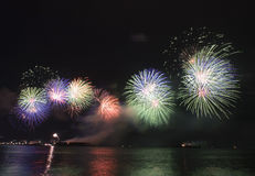 Fireworks display. Colorful fireworks display on the sea Royalty Free Stock Photography