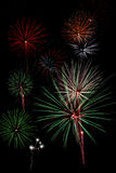 Fireworks Display. A composition of a firework celebration on dark black sky Royalty Free Stock Images