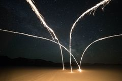 Fireworks Display on Brown Sand during Nighttime Royalty Free Stock Photography